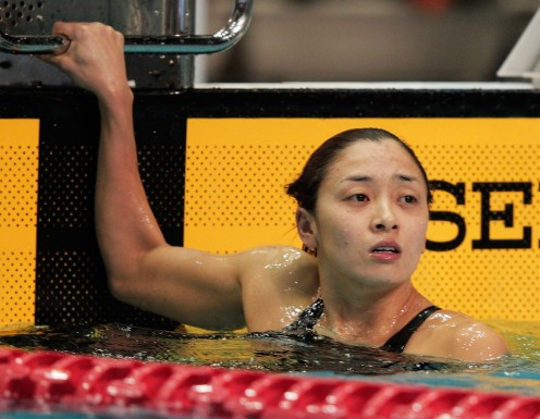 Hanae Ito of Japan reaches the end of the 200 meter freestyle semifinal as she looks on to see what is going to happen.