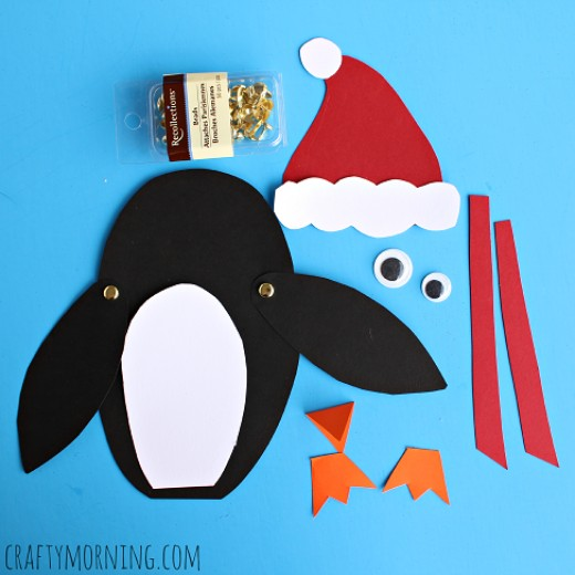 Cut up your penguin parts from the construction paper and then you put them all together.  You can also get some googly eyes.