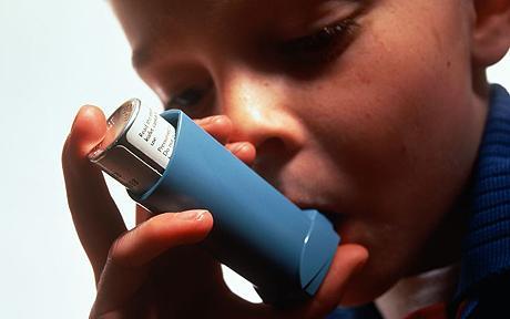 A child using an inhaler.