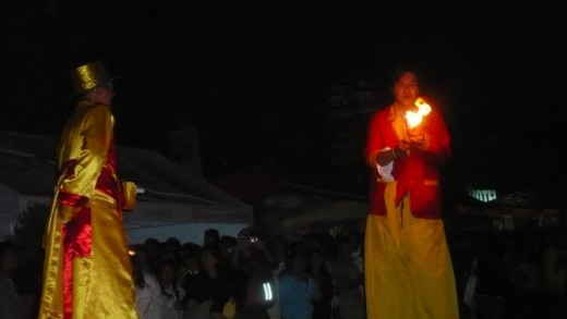 The giants performing magic to the crowd