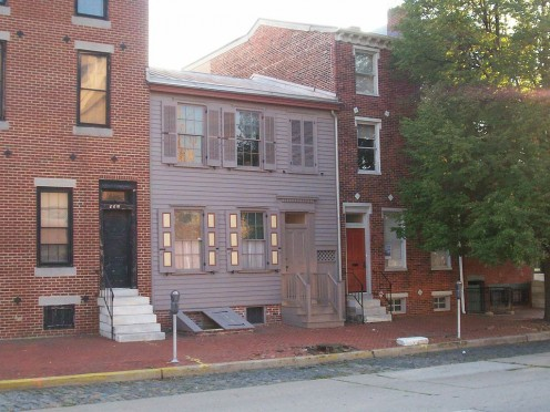 The Walt Whitman House in Camden, NJ is the shorter, gray frame house.