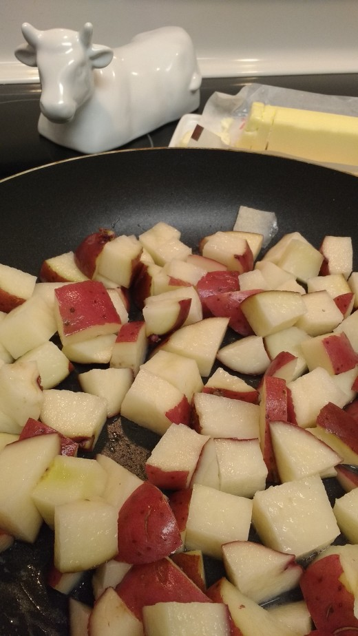 potatoes cooking in butter