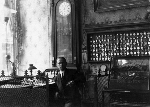 A period jeweler in his shop