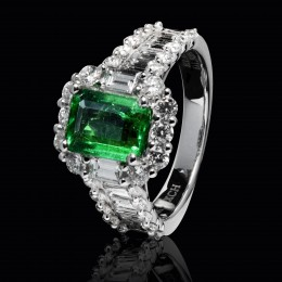 This ring contains an emerald with it's representative step cut. Diamonds cut in the same way make for a very prestigious look