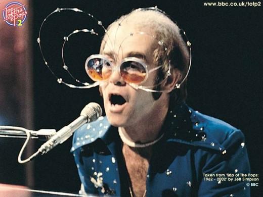 It's Cosmic Elton and His Amazing Orbiting Glasses