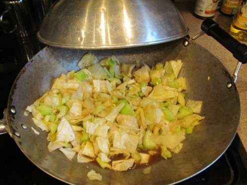 Add all Ingredients to wok: Stir Fry Sauce, Vegetables:  Including (canned bamboo shoots & baby corn).