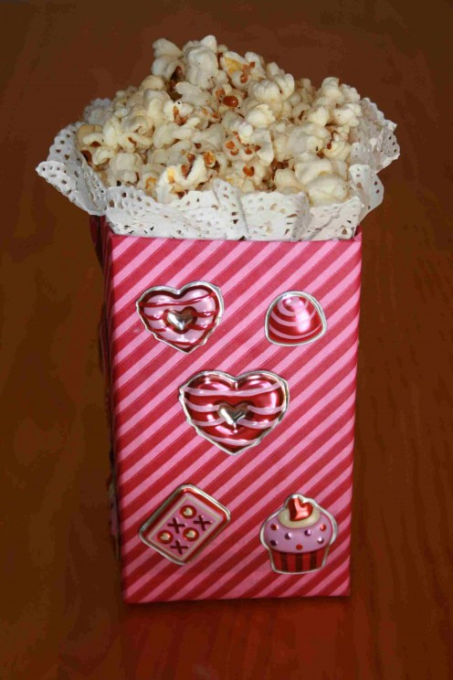 Completed pink stripe box for party with popcorn.