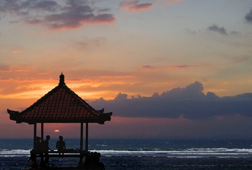 Serene sunset on Sanur beach.