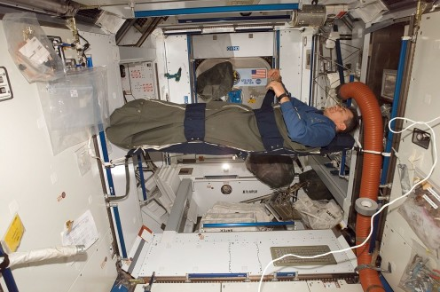 In other vehicles, astronauts have hung on the wall in a sleeping bag.