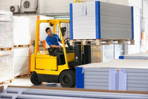 Side-view of a forklift that is equipped with a backup alarm.