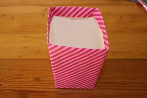 Cover box with some candy striped wrapping paper or leftovers from your gift giving at Christmas time.