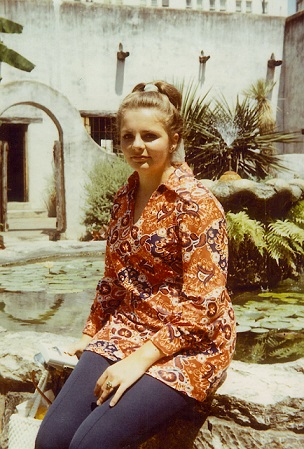 Photo of me at Spanish Governor's Palace in 1970.  I am seated on the stone fountain in the middle of the courtyard.