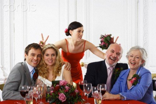 "See the hostess (in red)? She is showing her ""real"" feelings at  your always being at EVERY party in the neighborhood."