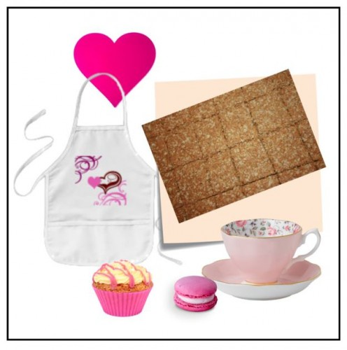 Cute pink graphic on apron and pink cakes.
