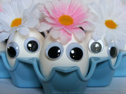 Another super simple egg decorating idea for Easter.  You will need some glue, some googly eyes and some silk flowers.