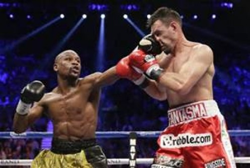 "Floyd Mayweather, who retired with a record of 49-0, is seen here in his victory over ""The Ghost'."