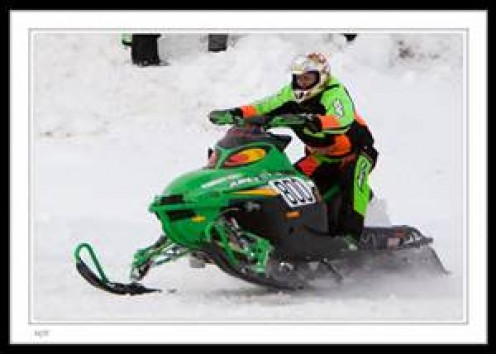 Snow Mobile racing is fun to watch and it can be dangerous but entertaining to participate in as well. Snow Mobiles are used for recreation, sport and for emergencies. Always wear a helmet to help prevent serious injuries.