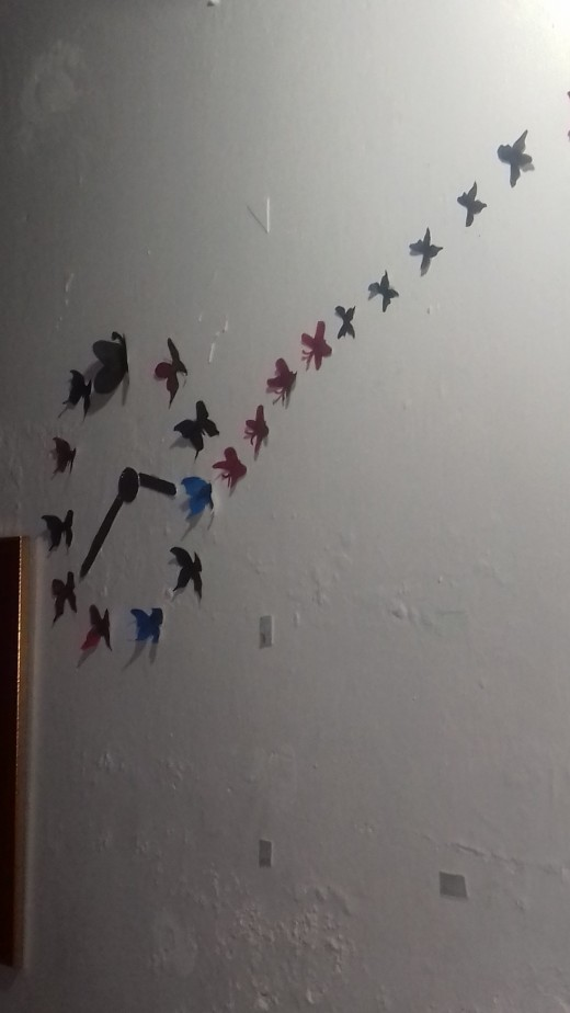 I ran a flight of butterflies from the living room to my bedroom ceiling.