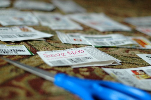 Clipping coupons, time consuming but necessary to save money