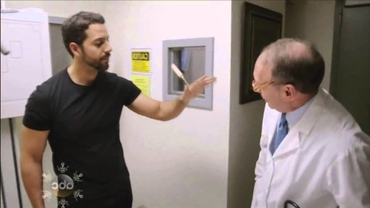 David Blaine shows off a tool stabbed through his hand to a Doctor
