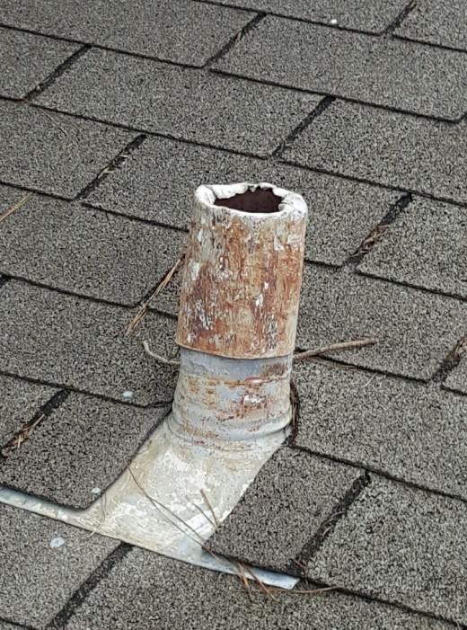 Bare flashing; don't think your roofer skipped something on you, this is commonly done in a residential application. Homeowners don't know enough to ask for them.