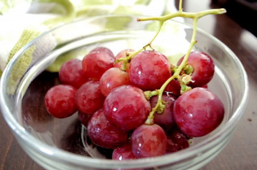 Although a good size for a treat for your pet, grapes are very harmful to them.