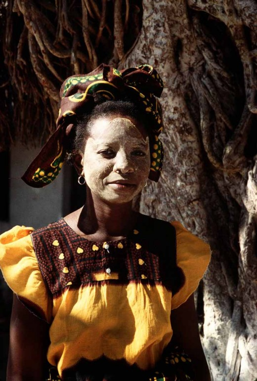 Woman with traditional mask in Mozambique