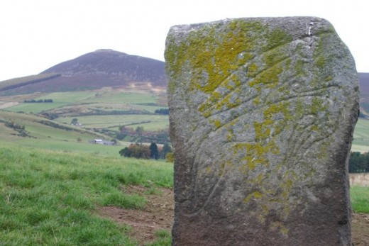 The Craw Stane with Tap O'North in the background (once an Iron Age hill fort).
