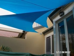 Here is an aqua blue colored outdoor shade sail.  Photo by http://www.flickr.com/photos/38613773@N02/3550691294/