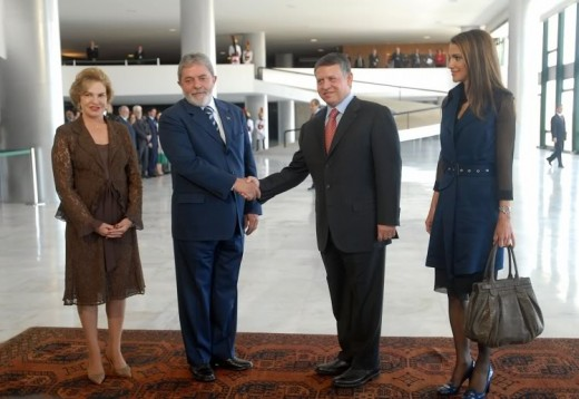 King Abdullah of Jordan greeting one time President of Brazil Lula.  Abdullah says Jordan cannot keep taking Syrians.