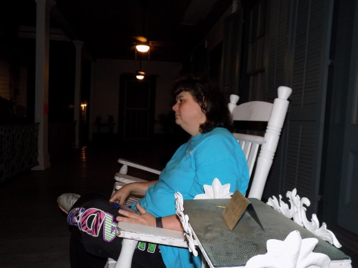 Donna Sitting on the Porch of the Main House