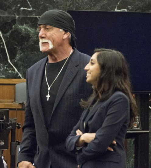 Hogan and a member of his defense team.