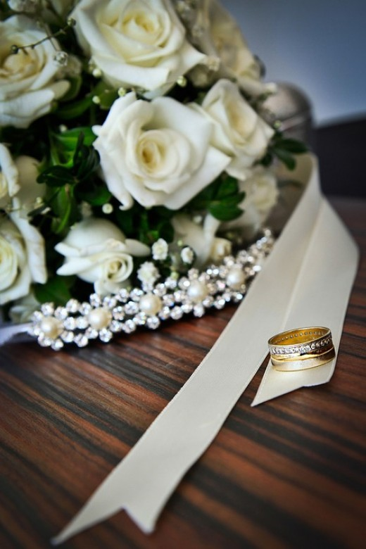 In typical traditional weddings the bride carries white flowers.