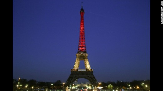 The Eiffel Tower lit up with the colors of the Belgian flag