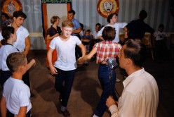 Adolescents learn the fine art of square dancing.