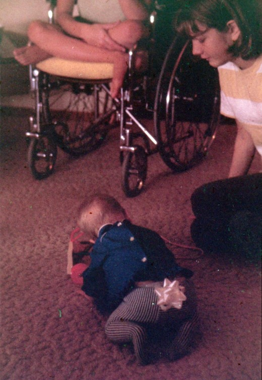 My sister Karen is in the wheelchair at the top.  Margie is to my right, and I'm the one with the bow on my butt.