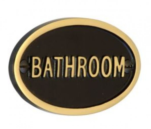An elegant embossed heavy cast polished brass or chrome sign for the bathroom or toilet door will give a clue to the style of what is to be found within.