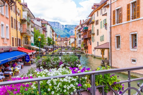 The panoramic landscape of Annecy with its old-world  charm and idyllic, alpine settings.