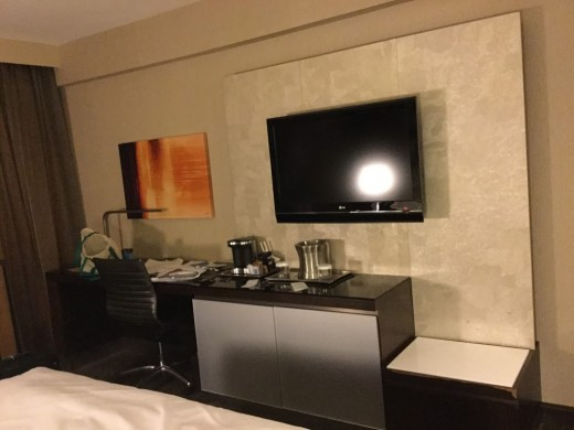 Room amenities. There is the TV, and even a coffee machine with some pods, so that you can enjoy a break at any time