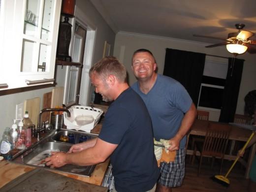 Men:  Doing housework namely washing up.