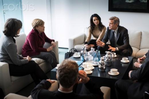 Clooney meets  German Chancellor,  Angela Merkel.