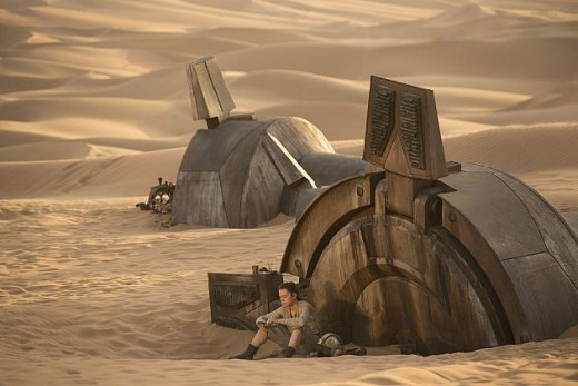 Rey waits alone on Jakku for her family to return