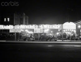 1930s new and used  car lot at Sixth Avenue  and Waverly St.,  Greenwich Village, New York City.   Photo made  Jan 1, 1930.