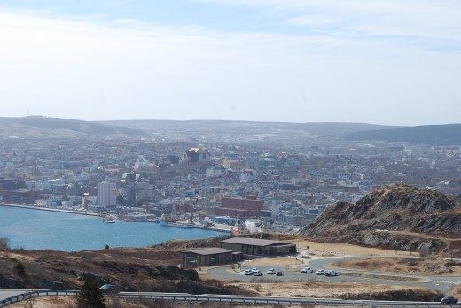 View of St. John's Harbour and downtown from the boardwalk, Lookout Trail. The Visitor Interpretation Centre, the Tattoo Performance Field, and Gibbet Hill can be seen in the foreground.