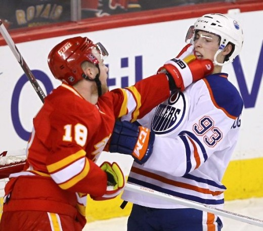 Matt Stajan merely trying to wipe something off Ryan Nugent-Hopkins' face