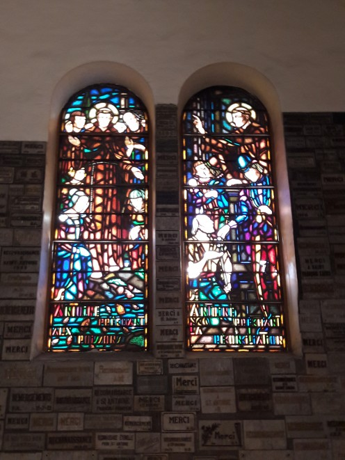 Colorful glass windows are telling such a holy tale
