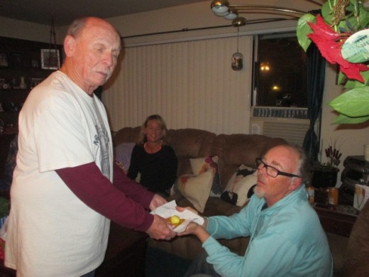 Dad sharing his pickled eggs with The Captain.  That's my sister Cindy back there.