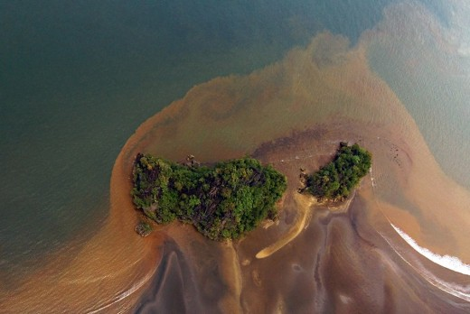 An islet at Claver, Surigao, Philippines engulfed by mine tailing.