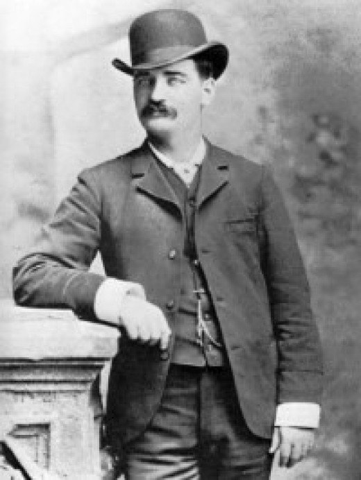 Bat Masterson wearing a bowler or derby.