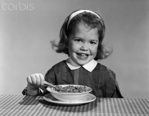 TV commercials about cereals in  the 1950s and 60s  mostly used a girl or boy  always smiling while  eating cereal.